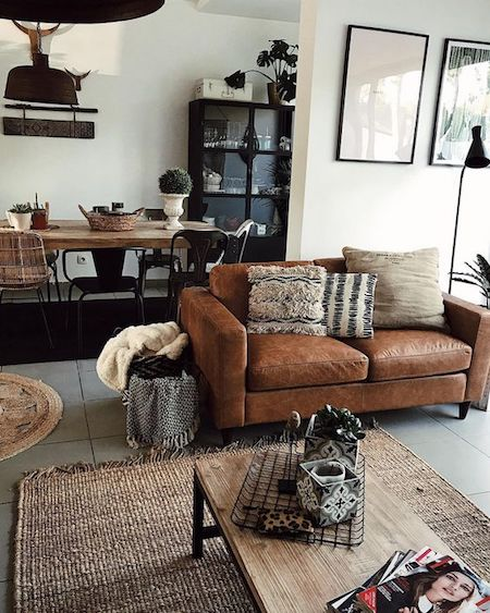 Brown leather couch with industrial decor